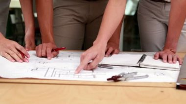 Team of architects studying blueprints — Vídeo de Stock