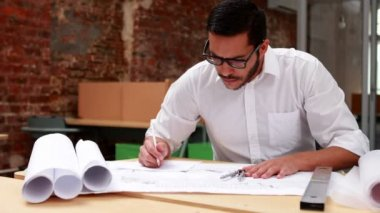 Architect going over blueprints — Vídeo de Stock