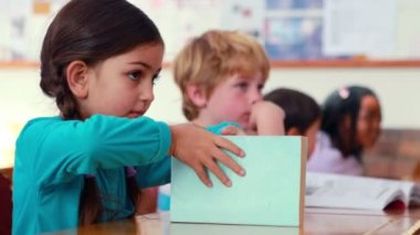 Pupil at her desk in classroom — Stock Video