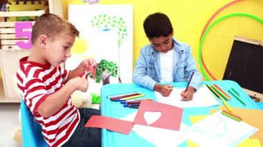 Boys having art time in the classroom — Stockvideo