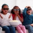 Children watching 3d movie on the sofa — Stock Video #50510339