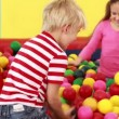 Children playing in the ball pool — Stock Video #50510647