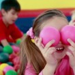 Children playing in the ball pool — Stock Video #50510719