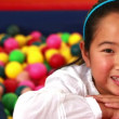 Cute girl in ball pool — Stock Video #50510917