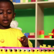 Boy playing xylophone in classroom — Stock Video #50510953