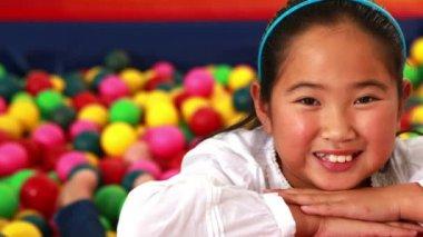 Cute girl in ball pool — Stock Video