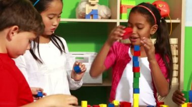 Classmates playing with building blocks — Stock Video