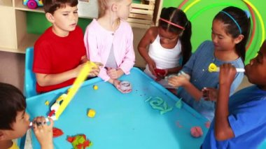 Cute classmates playing with clay — Vídeo Stock