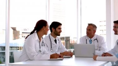 Medical team meeting together with laptop — Stock Video