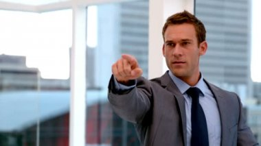 Stern handsome businessman pointing ahead — Stock Video