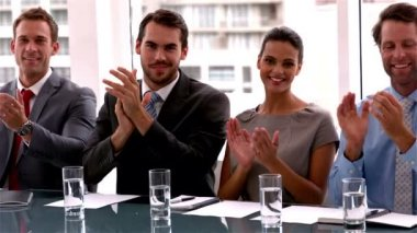 Business team applauding the camera at meeting — Wideo stockowe