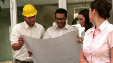 Architects going over blueprints with one — Vídeo de stock