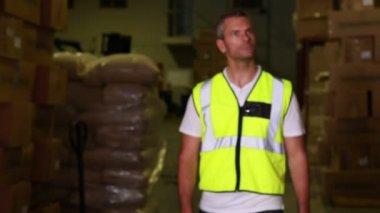 Warehouse worker walking towards — Stock Video