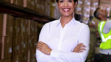 Warehouse manager smiling at camera — Stock Video