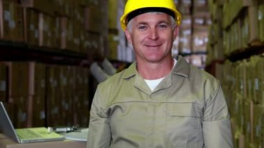 Warehouse worker smiling at camera — Stock Video