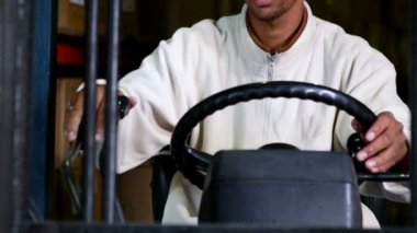 Forklift driver operating the machine — Stock Video