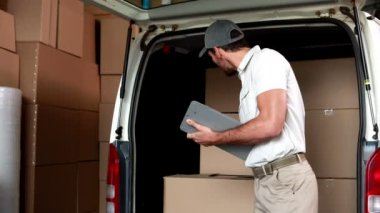 Delivery driver checking his list — Vídeo de stock