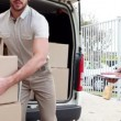 Delivery driver checking his list on clipboard — Stock Video #50533555