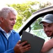 Delivery driver checking his list — Stock Video #50537509
