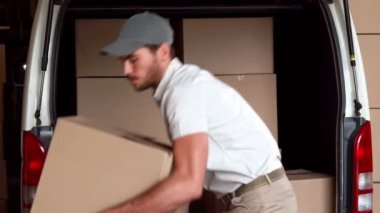 Delivery driver unloading his van — Stock Video