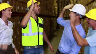 Warehouse team high fiving each other — Stock Video