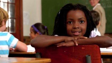 Cute little girl during class — Stock Video