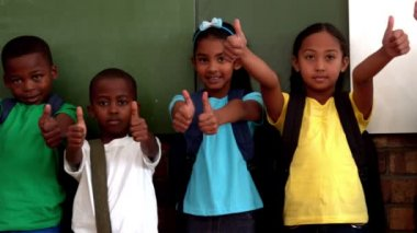 Pupils showing thumbs up in classroom — Stock Video