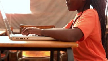 Little girl using laptop in classroom — Stock Video