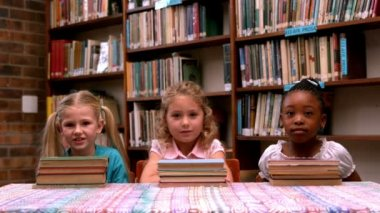 Girls posing with library books — Vidéo