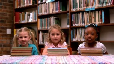 Girls posing with library books — Stock video