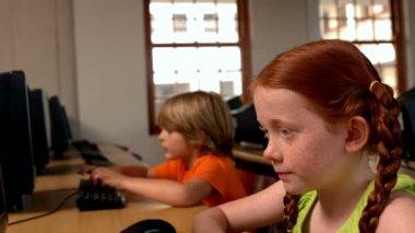 Girl using computer in classroom in school — Stock Video