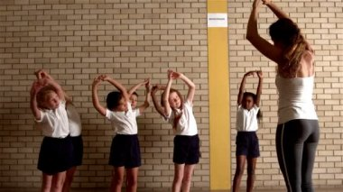 Pupils warming up with pe teacher — Stock Video