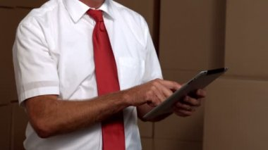Warehouse manager working on tablet pc — Stock Video
