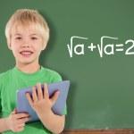 Boy using tablet against chalkboard — Stock Photo #51559289