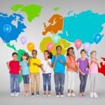 Elementary pupils holding balloons — Stock Photo #51559325
