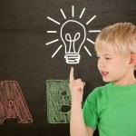 Boy pointing against blackboard — Stock Photo #51559473