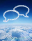 Cloud in shape of speech bubbles — Стоковое фото