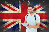 Student using tablet against union jack flag — Stock Photo