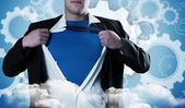 Businessman opening his shirt superhero style — Stock Photo