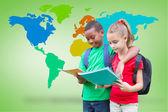 Pupils reading with world map — Stock Photo