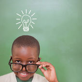 Pupil tilting glasses against idea graphic — Stock Photo
