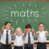 Word maths against cute pupils — Stock Photo