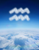 Cloud in shape of aquarius star sign — Stock Photo
