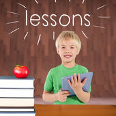 Lessons against red apple on pile of books — Stock Photo