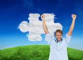 Man celebrating success with arms up — Stockfoto