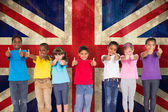Elementary pupils against union jack flag — Stock Photo
