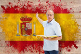 Teacher pointing against spain flag — Stock Photo