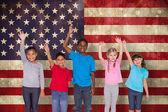 Pupils waving against usa flag — Stock Photo