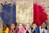 Cute pupils against france flag — Stock Photo