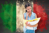 Student studying against italy flag — Stock Photo
